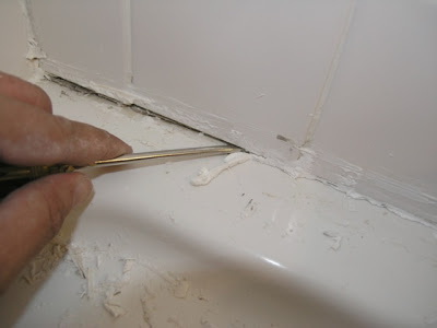 removing_caulk_with_screwdriver